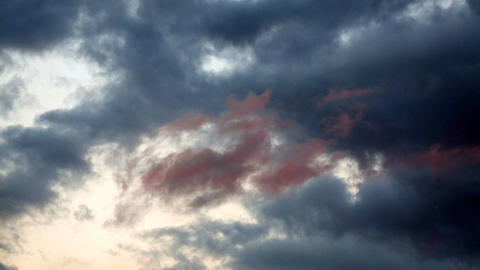 Dark clouds on a background of a bright sky Footage