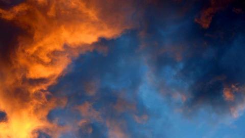 Sunset light. Sunlight illuminates the beautiful heavy clouds below Footage
