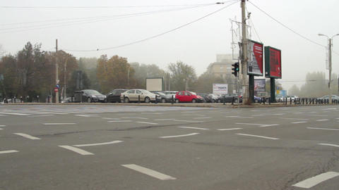 Autumn In The City, Pan Over An Intersection With Cars Passing By, Rush Hour Footage