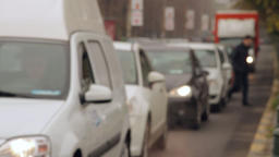 Busy Autumn Day In The City, Cars Stopping At Red Light, Cold Day, Rack Focus Footage