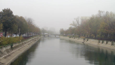 Downtown Bucharest On A Foggy Autumn Day, Pan Over The River, Traffic, Cold Day Live Action
