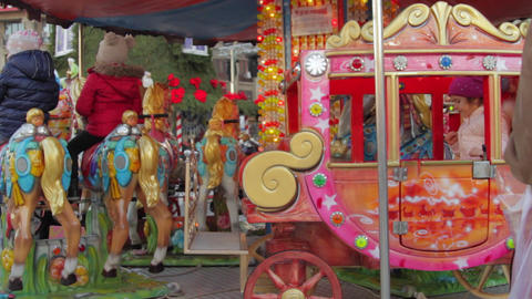 Winter Fair Carousel, Happy Kids Waiting For The Ride To Start, Pan Footage