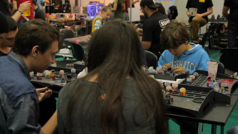 Kids Painting Figurines At Convention, Pan, Comicon Footage