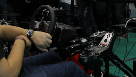 Teenager Playing On A Car Simulator, Sode Shot, Tournament, Comicon Footage