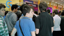 Crowd Of Teenagers Waiting In Line At Big Convention, Comicon Footage