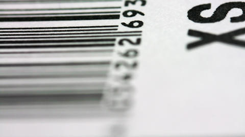 Short Fly Over A Bar Code Printed On A Price Tag Footage