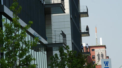 People In Balconies Of Business Center In Coffee Break, Smoking, Business Hours Live Action