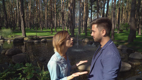 Boyfriend and girlfriend at the open air talking and dispute Footage