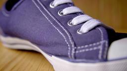 Blue canvas shoe stock footage Live Action
