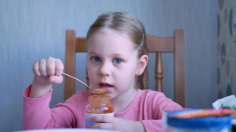 Pensive Child Girl Eating Fresh Fruit Puree Live Action