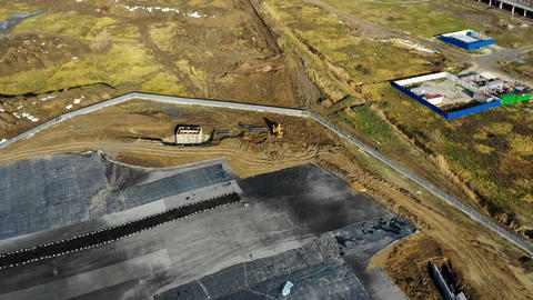 excavator works near area with tar and foil aerial view Live Action