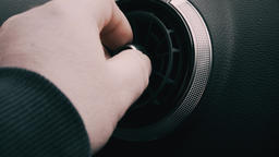 Hand adjusting air vent panel on car dashboard stock footage Live Action