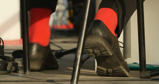person in red socks taps rhythm Live Action