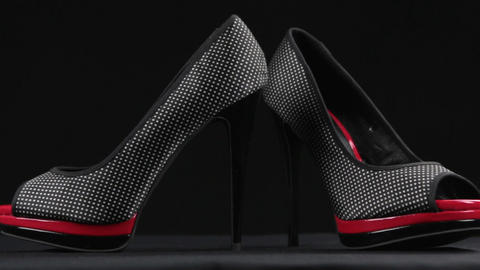 Close-up, a pair high-heeled shoes and platform. Slider shot. Female fashion Live Action