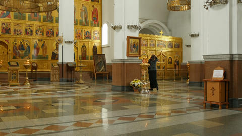 woman praying in orthodox church Footage