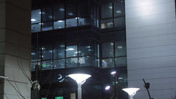 Business Center At Night, Illuminated, Street Lamp, People On The Street, Pan Live Action
