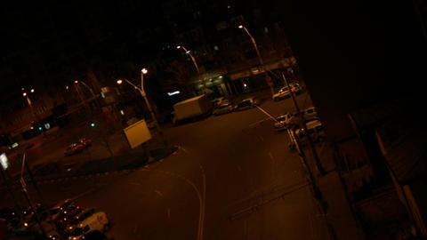 Pan Over A Street Late At Night, Dutch Angle, Cars Passing By, Night Traffic Footage