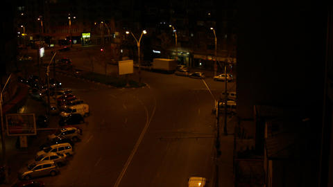 Aerial View Of A Street Late At Night, Pan, Night Traffic Live Action
