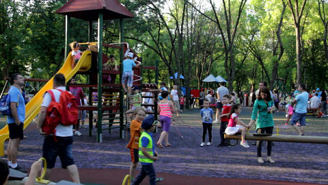 Park Full Of Kids And Parents On A Summer Afternoon, Kids Having Fun, Heat, Pan Footage