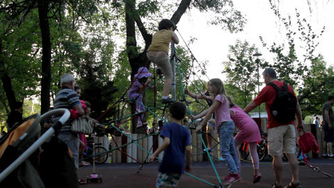Kids Climbing On Climbing Nets On A Summer Afternoon, Kids Having Fun, Park Live Action