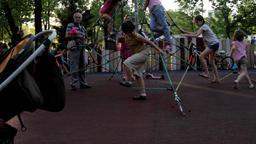 Kids Climbing On Climbing Nets On A Summer Afternoon, Kids Having Fun, Park Tilt Footage