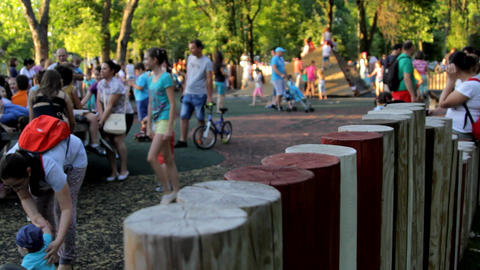 Park Full Of Kids And Parents On A Summer Afternoon, Kids Having Fun, Heat, Tilt Footage