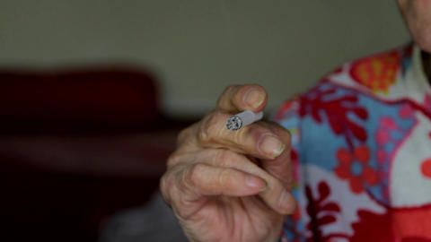Very Old Lady Smoking A Cigarette Before Going To Bed, Hand Detail Footage