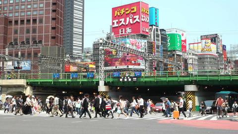 Tokyo- May 2016: People on crosswalk with colorful billboards in background and Footage