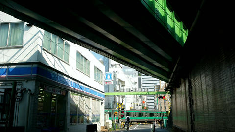 Tokyo- May 2016: Tokyo street view with railroad crossing and railway bridge. Sh Footage