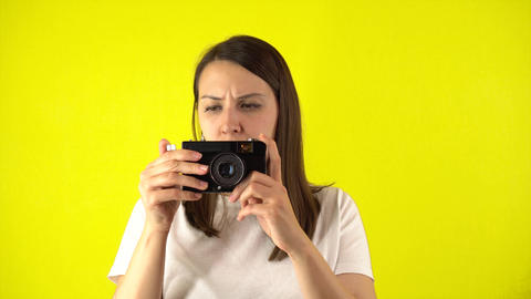 Young woman makes photo using vintage camera. Beautiful caucasian woman in t Live Action