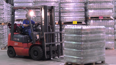 Large modern warehouse with forklifts at brewery Live Action