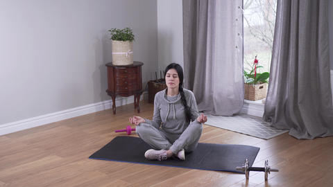 Top view long shot of relaxed Caucasian woman meditating indoors. Beautiful Live Action