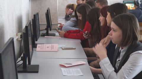 Female students in front of computers in a computer class Live Action
