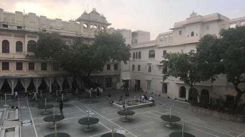 Udaipur, India - November 13, 2019: City Palace tourists relax in the courtyard Live Action