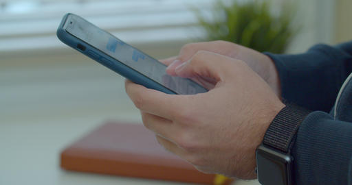 Man hands using a smart phone, close up. Young man holding mobile smart phone Live Action