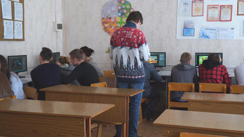 Students in front of computers in a computer class Live Action