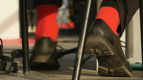musician in red socks taps rhythm Live Action