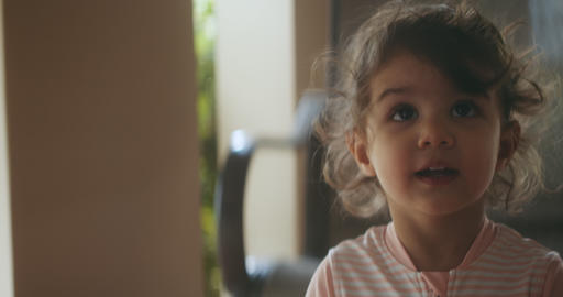 Portrait of beautiful little girl having fun on vacation Live Action