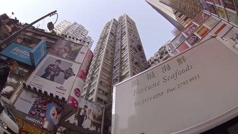 Commercial Signage and Highrise Buildings on a Busy Street. FullHD video Live Action