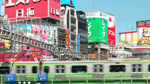 Tokyo- May 2016: Colorful billboards with train passing by. Shinjuku. 4K resolut Footage