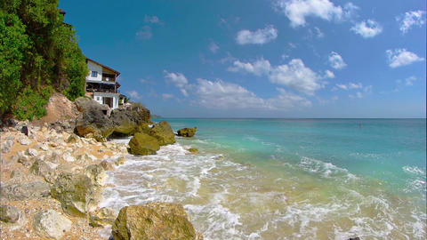 House on a Private. Rocky. Tropical Beach in Bali. Indonesia. FullHD video Footage