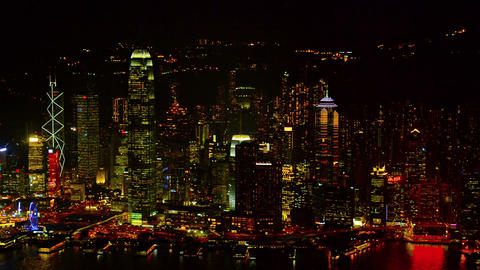 Hong Kong's Dramatically Lit Urban Skyline at Night. Video Live Action