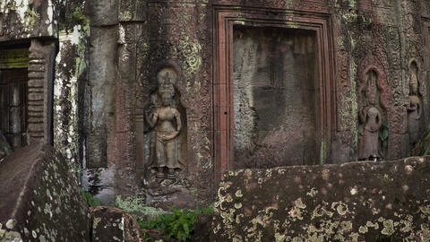 Intricate Stone Sculptures at Ancient Cambodian Temple Ruin. FullHD video Footage