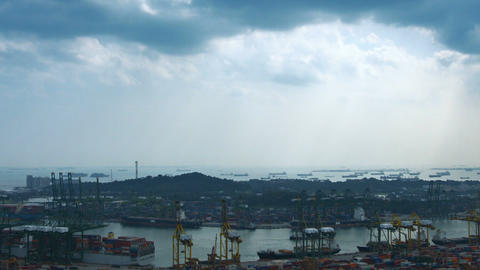 Overlooking view of Singapore's shipping port and cargo ships moored offshore Footage