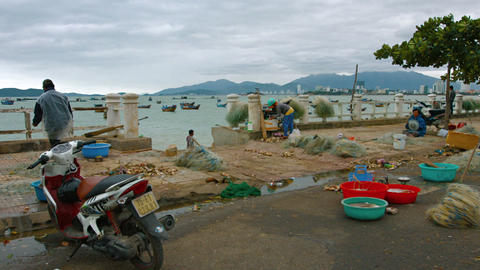 Local fishermen and women preparing nets for the daily catch Footage