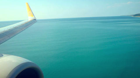 Airplane's Wing and Engine Crossing Beach and Landing. Video FullHD Footage