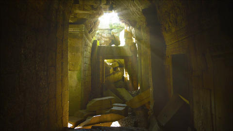 Dim Sunlight Filters through Hole in Roof of Ancient Temple Ruin Live Action