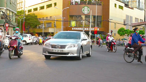 Vietnamese big city street during the day. Video FullHD Footage