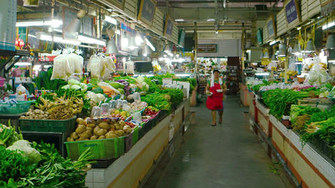 Wide variety of fresh vegetables and produce at indoor public market in Phuket Footage