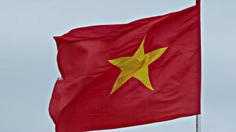 Vietnamese Flag Flapping in the Wind on a Cloudy Day Footage